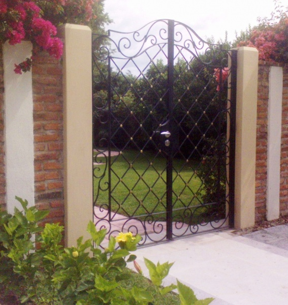 Home inicio el tempisque hererr a de beto mu oz for Puertas para jardin interior